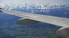 Plane wing with the Swiss countryside around the Gruyere lake Stock Footage