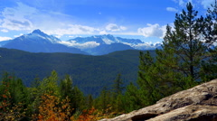 4K Rock Ledge and Trees in Foreground, Mountain Peaks in Background Stock Footage