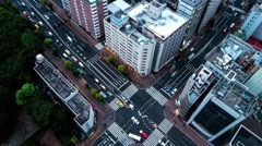 Tokyo - Aerial evening view of junction with traffic and people. 4K time lapse Stock Footage