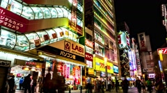 Tokyo -Night street view with people at colorful Akihabara Electric Town. 4K Stock Footage