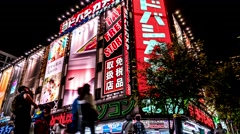 Tokyo night street view with glowing signboards and walking people, Shinjuku. 4K Stock Footage