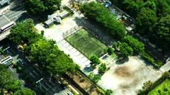 Tokyo - Aerial view of people playing football. 4K resolution time lapse zoom in Stock Footage