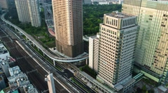 Tokyo - Aerial evening city view with trains and highway traffic. 4K time lapse Stock Footage