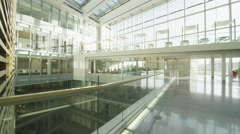 Interior view of a large contemporary office building with glass partitions Stock Footage