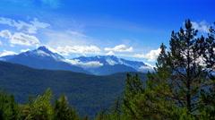 4K Blue Mountain Range, Snow Peaks and Blue Sky Wide Panorama Stock Footage