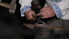 Blacksmiths make horseshoes, knock hammer Stock Footage