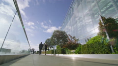 Time lapse group of business people walking outside modern office building Stock Footage