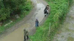 Refugees, exhausted family escaping from war, drone shot, slow motion by Sheyno. Stock Footage