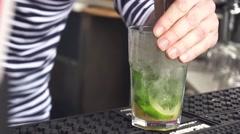 Close up of bartender making mojito cocktail at the bar Stock Footage