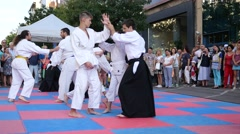 Demonstrative training karate sparring session on street urban cultural festival Stock Footage