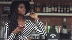 Gorgeous african american business lady waiting for somebody when drinking Stock Footage