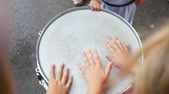 Children play drum with palms and drumsticks - music instrument demonstration Stock Footage