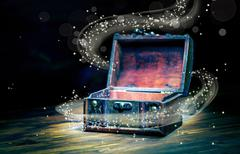 Beautiful concept greeting card of opened vintage chest treasure with miracle Stock Photos