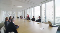 Corporate business team in boardroom meeting in city office Stock Footage