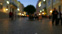 4K .Silhouettes of people on city street.   Night blurred scene, Focus change Stock Footage