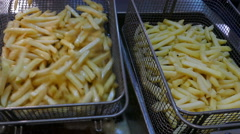 French fries in the fryer Stock Footage