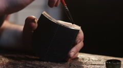 Painting  heel for men shoes. Shoemaker sews shoes Stock Footage