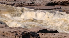 Hukou waterfall at Yellow river (Huang He) in Yichuan, China Stock Footage