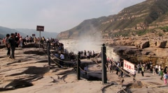 People enjoy the view to the Hukou waterfall at the Yellow river (Huang He). Stock Footage