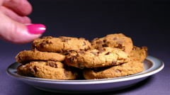 Hands taking chocolate chip cookies. Stock Footage