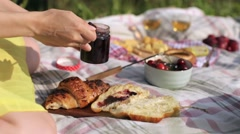 Girl Smears Jam on Croissant, Picnic Stock Footage