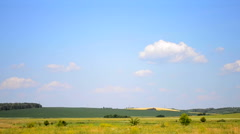 Sky with clouds over the field on a hot summer day Stock Footage