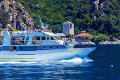 OURANOPOLIS, GREECE - JUNE 05, 2009: Touristic ship near Port Dafna Stock Photos