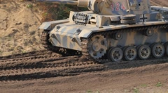 Military Tank driving on battle field Stock Footage