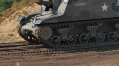 SEXTON Military Tank driving on the battle field Stock Footage