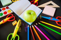 Back to school. Notepad with apple and supplies Stock Photos