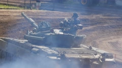 Military Tank driving through smoke on battle field Stock Footage