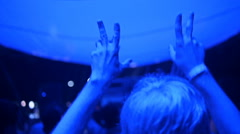 Large group of happy people enjoying rock concert, clapping with raised up hands Stock Footage