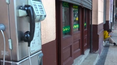 A public telephone along the street in Havana, Cuba. Stock Footage