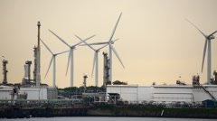 Refinery silos and wind power Stock Footage