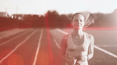 Slow motion. Hot air evoporates. Beautiful young woman exercise jogging and Stock Footage
