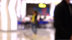 Blurred customers walking in modern shopping center near food court. 4K Stock Footage