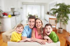 Happy family at home. Stock Photos