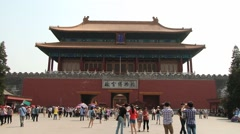 Tourists walk in front of the gate of the Gugun palace in Beijing, China. Stock Footage