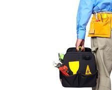 Hand of handyman with a tool bag. Stock Photos
