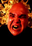 Angry man with flames Stock Photos