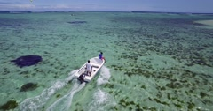 4K Low level Drone Shot Tracking Boat over Clear Blue Water in Mauritius Stock Footage