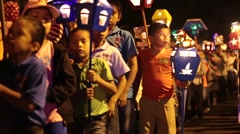 Children marching towards camera in light parade in panama at night Stock Footage