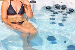 Beautiful woman relaxing in hot tub. Kuvituskuvat