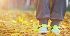 Sportswoman Jumping in the Autumn City, Close up. 4K SLOW MOTION 120 fps. Stock Footage