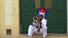 A musician plays a trumpet on the streets of Havana, Cuba. Stock Footage