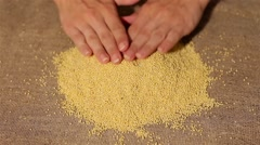Wheat smooth out on burlap. harvesting. smooth out hands Stock Footage
