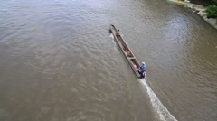 Motorized boat running down river through jungle Stock Footage