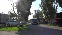 Camper leaves RV campground in Ventura Stock Footage
