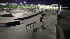 Skateboarders doing Jumps and Rides in Park Stock Footage