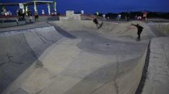 Teen Boy Falls of Skateboard and Runs up Wall Stock Footage